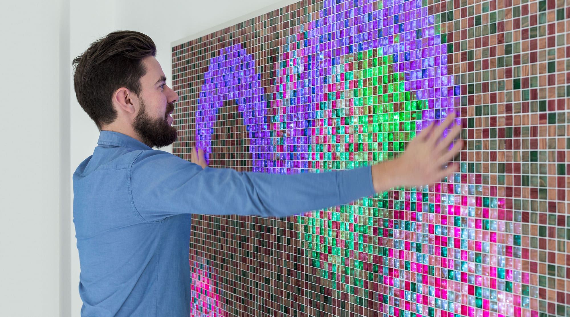 Multi-touch gestures by visitor on LED wall in CBM foyer