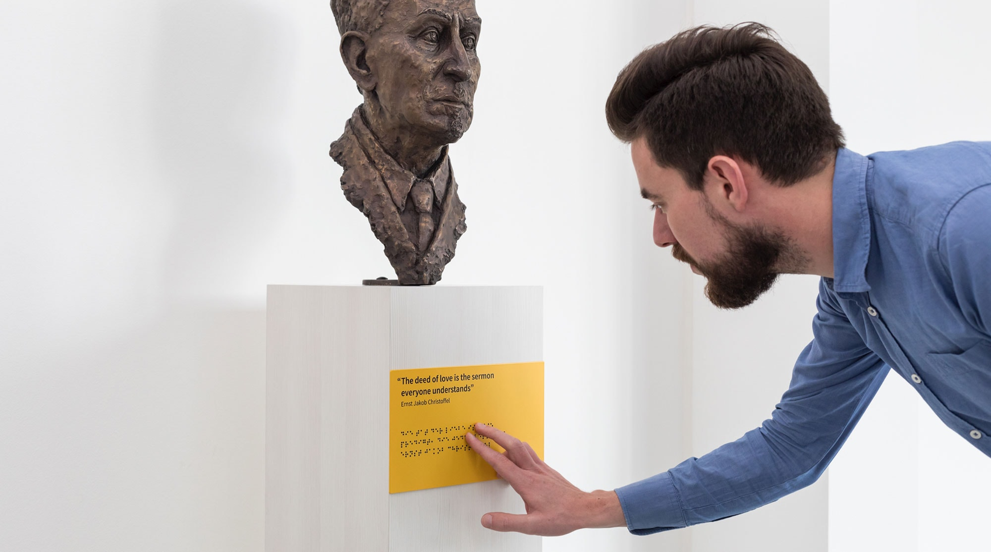 Reading braille writing on the Ernst Jakob Christoffel statue