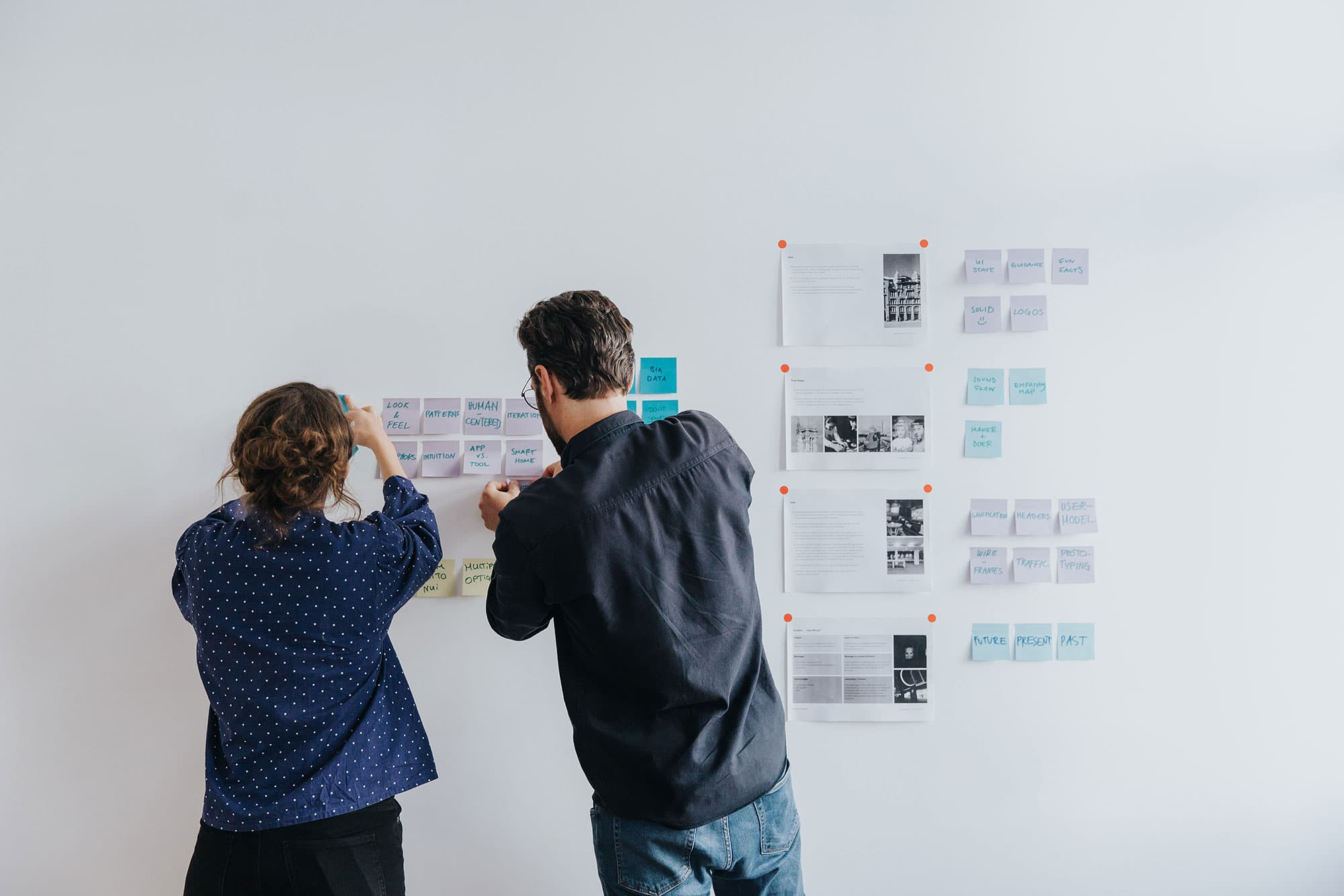 Designers using post-its for ideation workshop